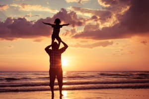 46432351 - father and son playing on the beach at the sunset time. concept of friendly family.